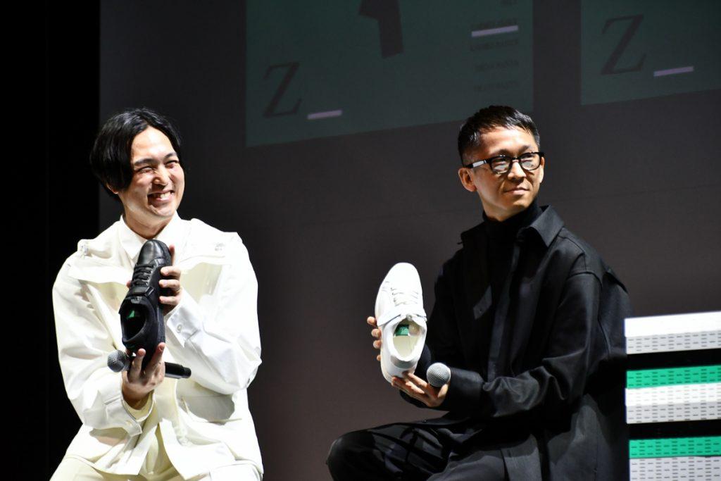 制服デザインを担当したファッションデザイナーの堀内太郎氏(写真右)とSIX inc.のアートデザイナー矢後直規氏(写真左)